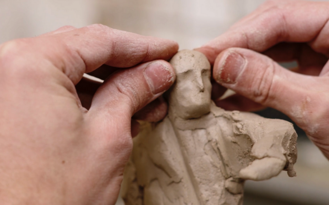 Building the clay sketch for a stone sculpture